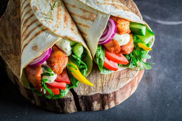 Healthy grilled tortilla with fresh vegetables and chicken
