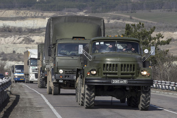 Russian Army trucks drive on the road from Sevastopol to Simferopol in the Crimea region