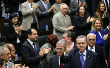 Turkey's Prime Minister Tayyip Erdogan greets members of parliament from his ruling AK Party (AKP) during a meeting at the Turkish parliament in Ankara