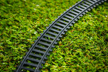 railway track on green grass field