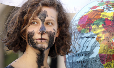 "Greenpeace activists protest against oil disasters and offshore drilling at a ""petrol mob"" event in Lyon"