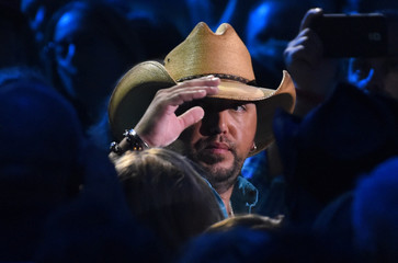 """Aldean takes the stage to accept the award for CMT performance of the year for """"Turn the Page"""" with Seger during the 2015 CMT Awards in Nashville"""