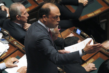 Secretary of Berlusconi's People of Freedom party Alfano reads his speech during a vote of confidence at the Lower House of Parliament in Rome