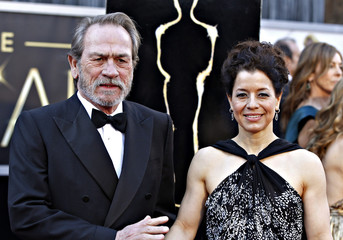 """Tommy Lee Jones, best supporting actor nominee for his role in """"Lincoln"""", and his wife Dawn Laurel-Jones arrive at the 85th Academy Awards in Hollywood"""