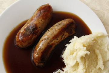 A traditional British meal of sausages and mashed potato in gravy, known as Bangers and Mash, is pictured in G. Kelly's pie and mash shop in east London