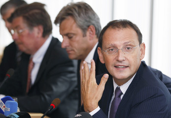 Mariani, chief executive of Belgian-French financial services group Dexia addresses a news conference in Brussels