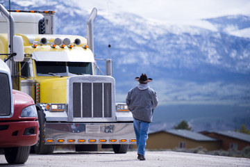 Truck driver going to customized impressive yellow semi truck Wall mural