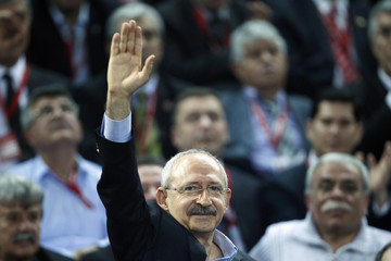 The Republican People's Party leader Kemal Kilicdaroglu greets his supporters as he arrives to his party's congress in Ankara