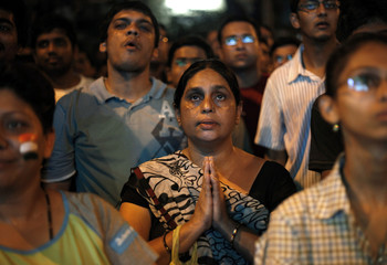 Fans react as they watch the ICC Cricket World Cup semi-final match between India and Pakistan on a screen in Mumbai