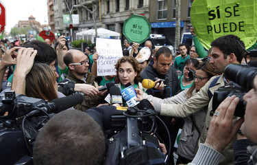 Colau, spokesperson for the Mortgage Victims' Platform, attends a news conference, during a rally in front of  Partido Popular headquarters in Barcelona