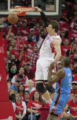 Houston Rockets center Asik dunks the ball over Oklahoma City Thunder forward Ibaka during Game 4 of their NBA Western Conference quarter-finals basketball playoff series in Houston