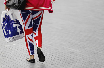 A woman wears leggings in the colours of the Union Flag, in central London