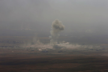 Smoke rises from clashes in the east of Mosul during clashes with Islamic State militants
