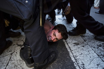 A protester is detained by New York police during a demonstration calling for social, economic and racial justice, in the Manhattan borough of New York City