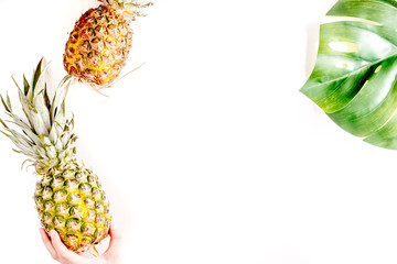 summer dessert with pineapples and plant on white background top view mock up