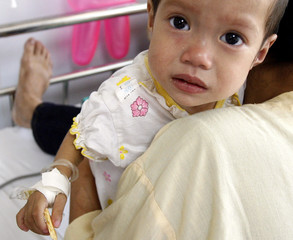 A HIV-positive girl is seen at the paediatric hospital in Hanoi