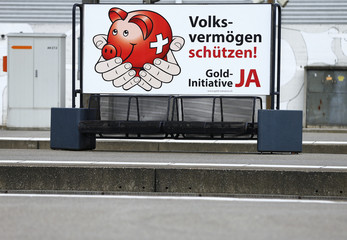 A banner for the gold initiative is seen at the main train station in Zurich