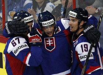 Slovakia's Zaborsky, Kukumberg and Miklik celebrate their goal against France during their 2013 IIHF Ice Hockey World Championship preliminary round match at the Hartwall Arena in Helsinki