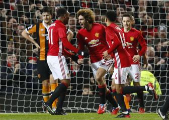 Manchester United's Marouane Fellaini celebrates scoring their second goal with teammates