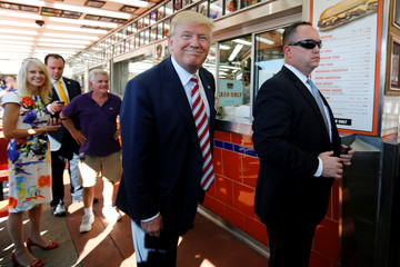 Republican presidential nominee Trump smiles at a question from a reporter as he makes a stop at Geno's Steaks cheesesteak restaurant in Philadelphia