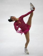 Asada of team Japan performs during the ladies' singles short program during China ISU Grand Prix of Figure Skating , in Beijing