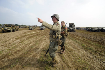 Participants dressed as U.S. soldiers take part in an annual military display in Mesvin, Mons