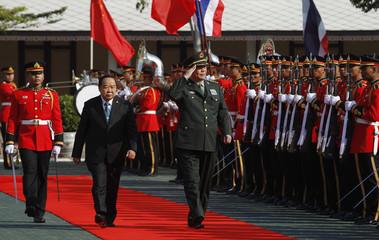 Chang reviews a guard of honour at the Defence Ministry in Bangkok