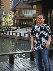 Chinese mogul Zhang Baoquan poses at Mangrove Tree Resort on Sanya Bay in Hainan island