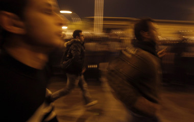 Egyptian Christians run during clashes with riot police outside al-Abasseya Cathedral in Cairo