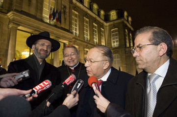 French Religious leaders speak with media after attending the New Year's speech by France's President Sarkozy at the Elysee Palace in Paris