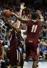 Clemson Tigers guard Andre Young (11) shoots against Boston College Eagles forward Corey Raji (11)  during their NCAA men's basketball game at the 2011 ACC Tournament in Greensboro