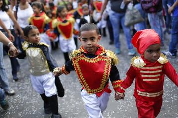 Children dressed as Venezuelan national independence hero Simon Bolivar parade during the Carnival festival in Caracas