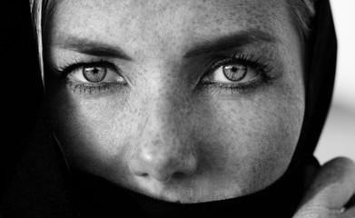 Woman face with deep eyes portrait, black and white photo session in the arabic style, monochrome, deep strong eyes