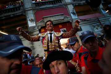 "Spanish bullfighter ""El Juli"" leaves the bullring on the shoulders of supporters after his good performance with the bulls at the end of a bullfight during the San Fermin Festival in Pamplona"