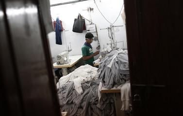 Employee works inside a garment factory in New Delhi