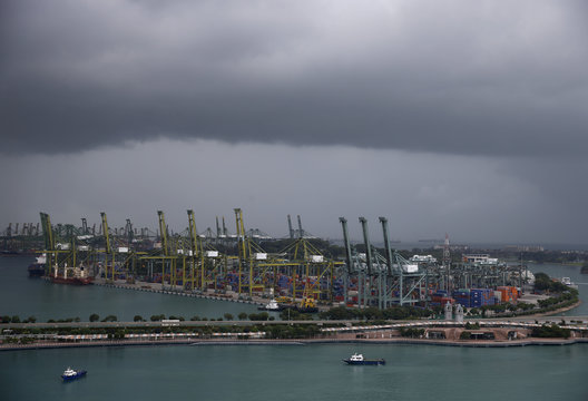 Storm clouds gather over PSA's Pulau Brani container terminal in Singapore