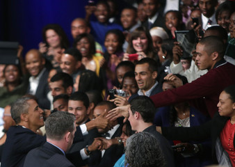 U.S. President Obama greets students before a town hall meeting in Soweto