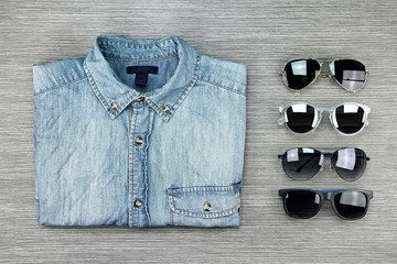 Men Fashion, Set of clothes and various accessories, Blue jeans shirt and stylish sunglasses. Set of Sunglasses.