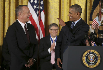 U.S.  President Obama reacts with actor Hanks before presenting the Presidential Medal of Freedom during White House ceremony in Washington