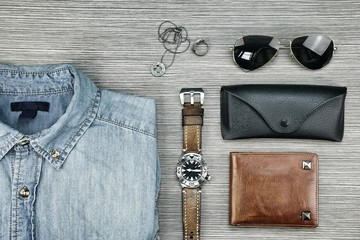 Men accessories and fashion, Set of clothes and various accessories, Trendy Hipster style outfits, Jeans Shirt, Watch, Wallet, Sunglasses, Necklace, Ring. (Color Process)