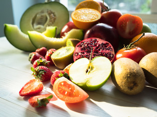 Various of fresh fruits on the table, selected focus on strawberries