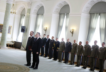 New Defence Minister Siemoniak and former Defence Minister Klich stand during an appointment ceremony at the Presidential Palace in Warsaw