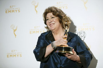 "Actress Margo Martindale poses with her Outstanding Guest Actress in a Drama Series award for her work on ""The Americans"" backstage at the 2015 Creative Arts Emmy Awards in Los Angeles, California"