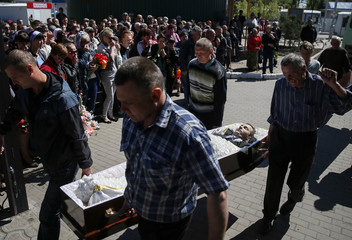 People carry a coffin containing the body of a man killed in a gunfight on Thursday, during a funeral ceremony in Slaviansk