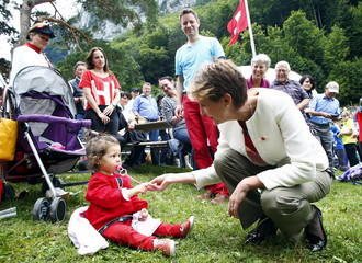 Swiss President Sommaruga plays with a girl during the Swiss national holiday celebrations on the Ruetli meadows