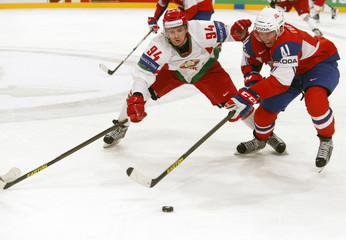 Belarus' Gavrus fights for the puck with Norway's Thoresen during their 2013 IIHF Ice Hockey World Championship preliminary round match at the Globe Arena in Stockholm