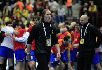 Sweden's coach Staffan Olsson reacts after losing the bronze medal match against Spain at the Men's Handball World Championship in Malmo