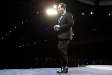 U.S. Republican presidential candidate and Santorum walks after speaking at the AIPAC policy conference in Washington