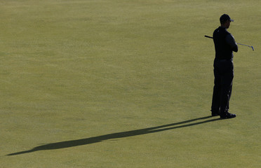 Woods of the U.S. stands on the fouth green during the second round of the British Open golf championship on the Old Course in St. Andrews, Scotland