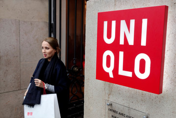 A customer leaves the casual clothing store Uniqlo operated by Japan's Fast Retailing in Paris, France